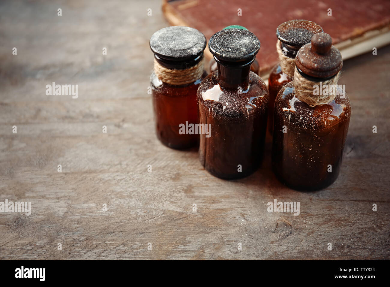 Vintage glass bottles on wooden background, closeup - Stock Image