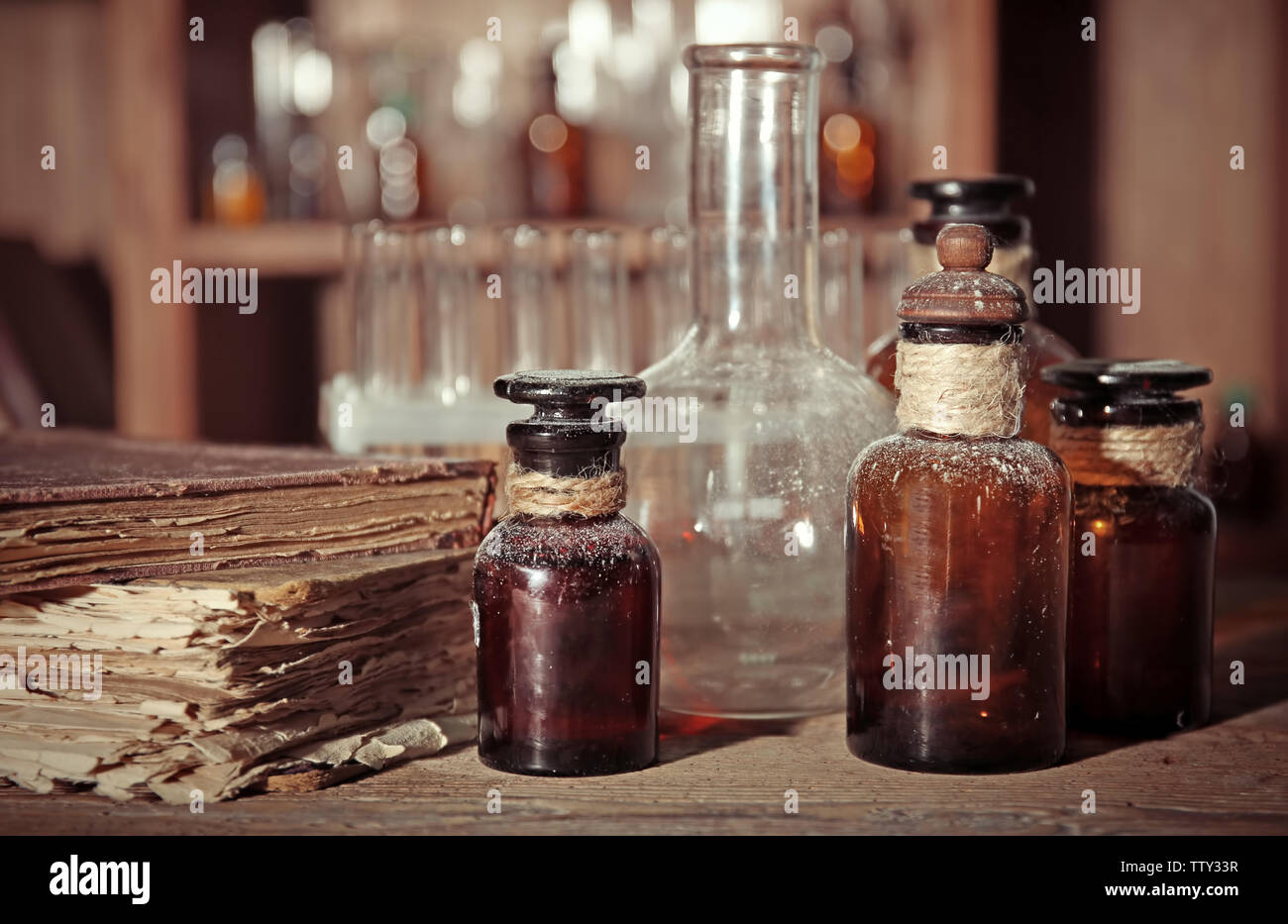 Vintage glass bottles on wooden table, closeup - Stock Image