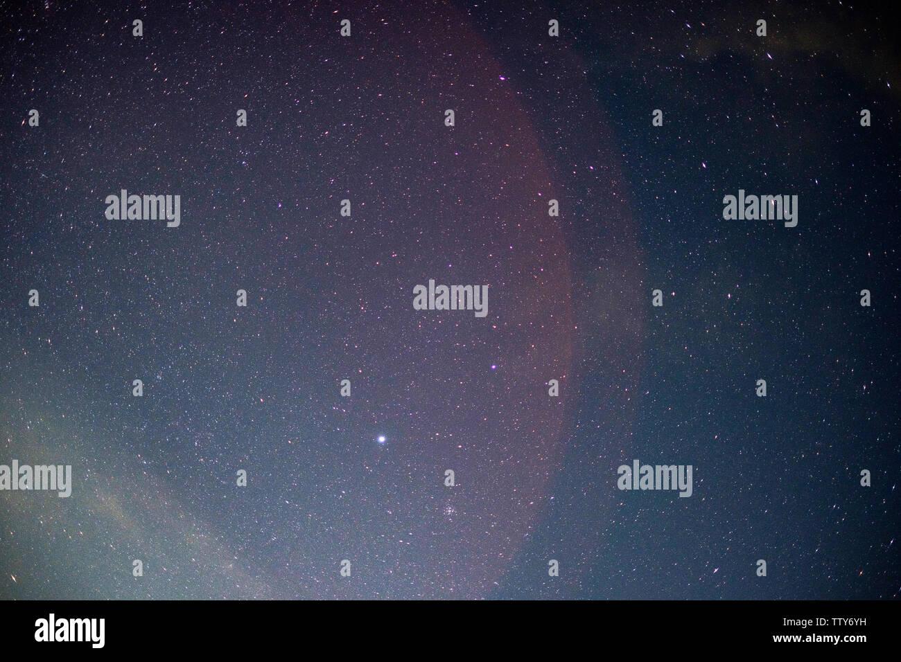 Beautiful night sky with stars and light radius - Stock Image