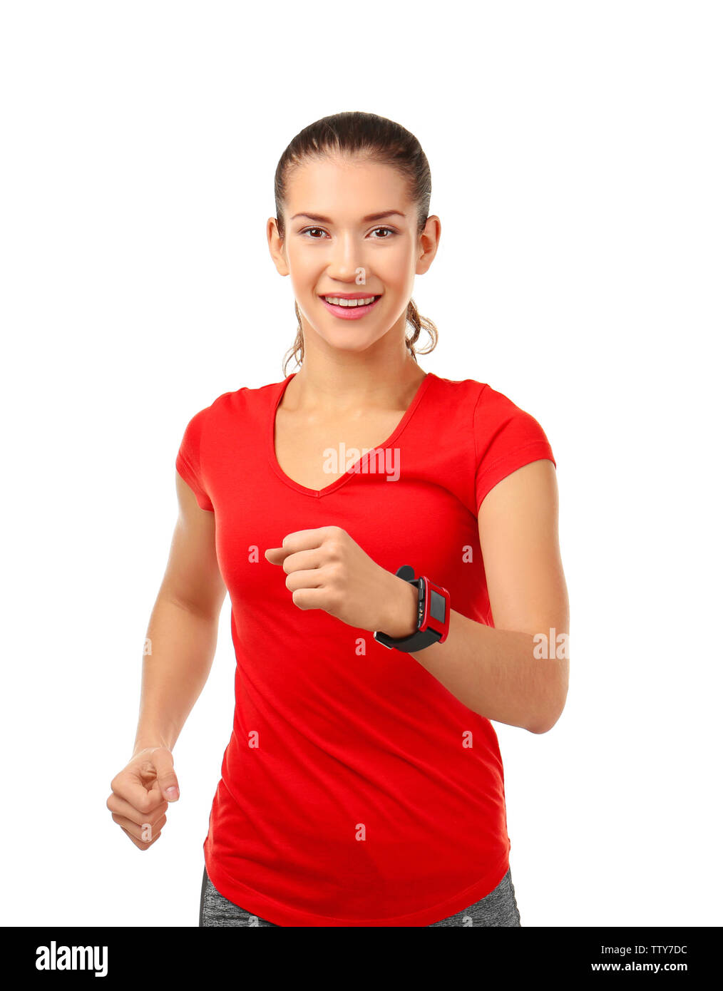Sporty young woman running on white background - Stock Image