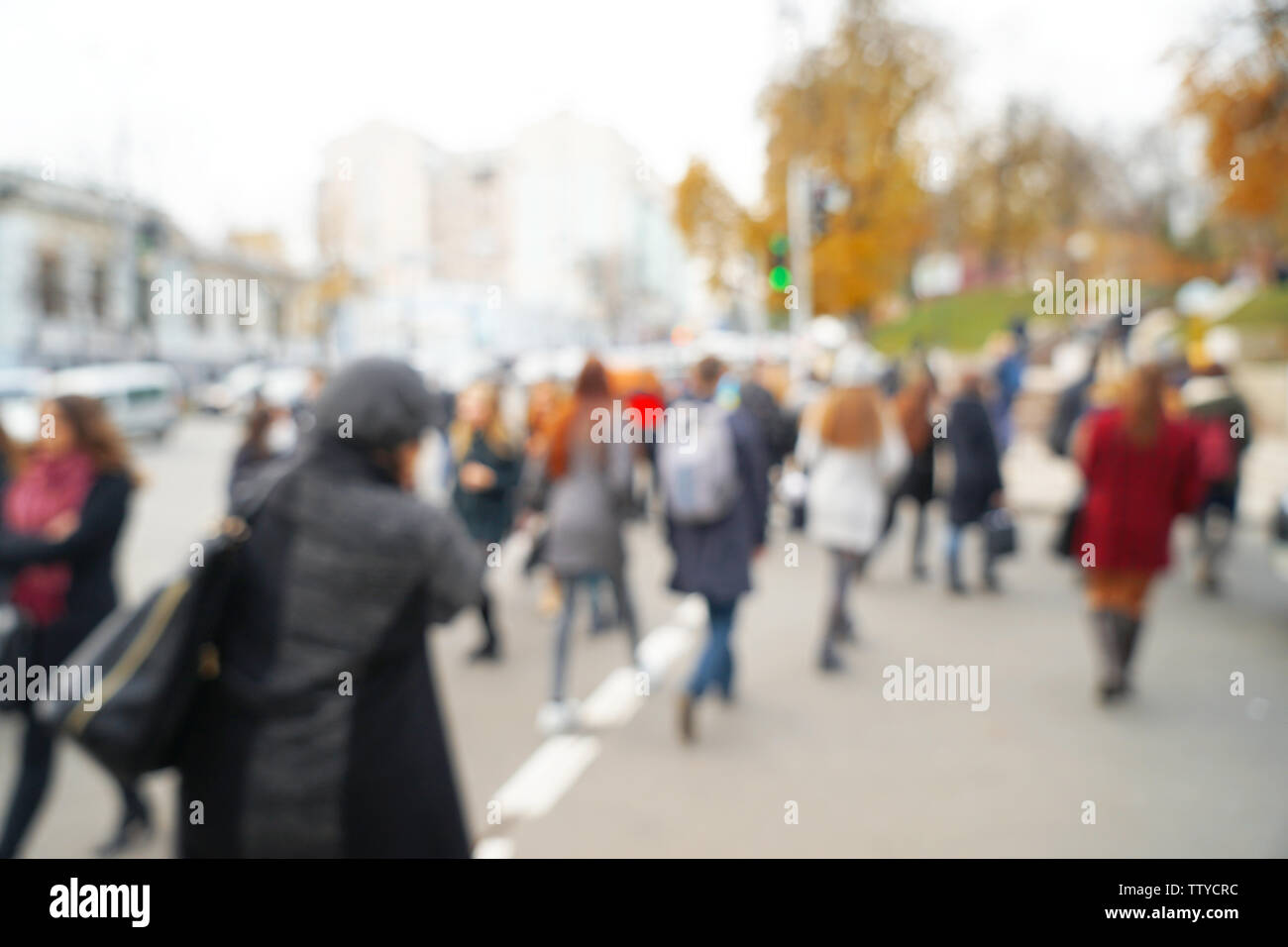 Blurred background of crowded city street - Stock Image