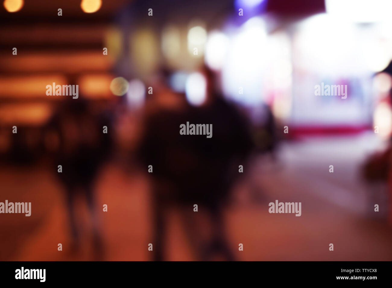 Blurred background of evening city street - Stock Image