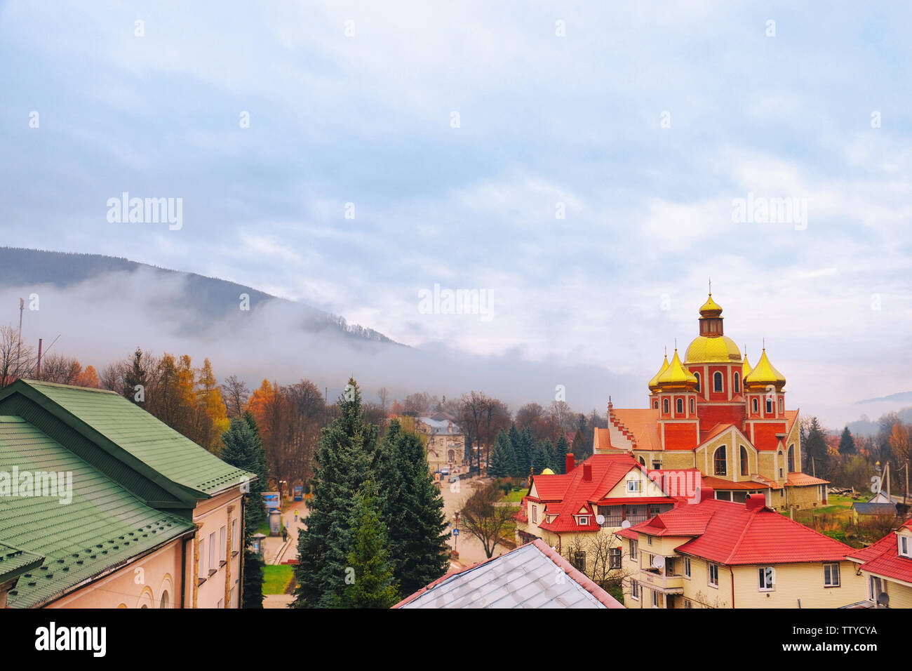 Beautiful resort with church in mountains - Stock Image