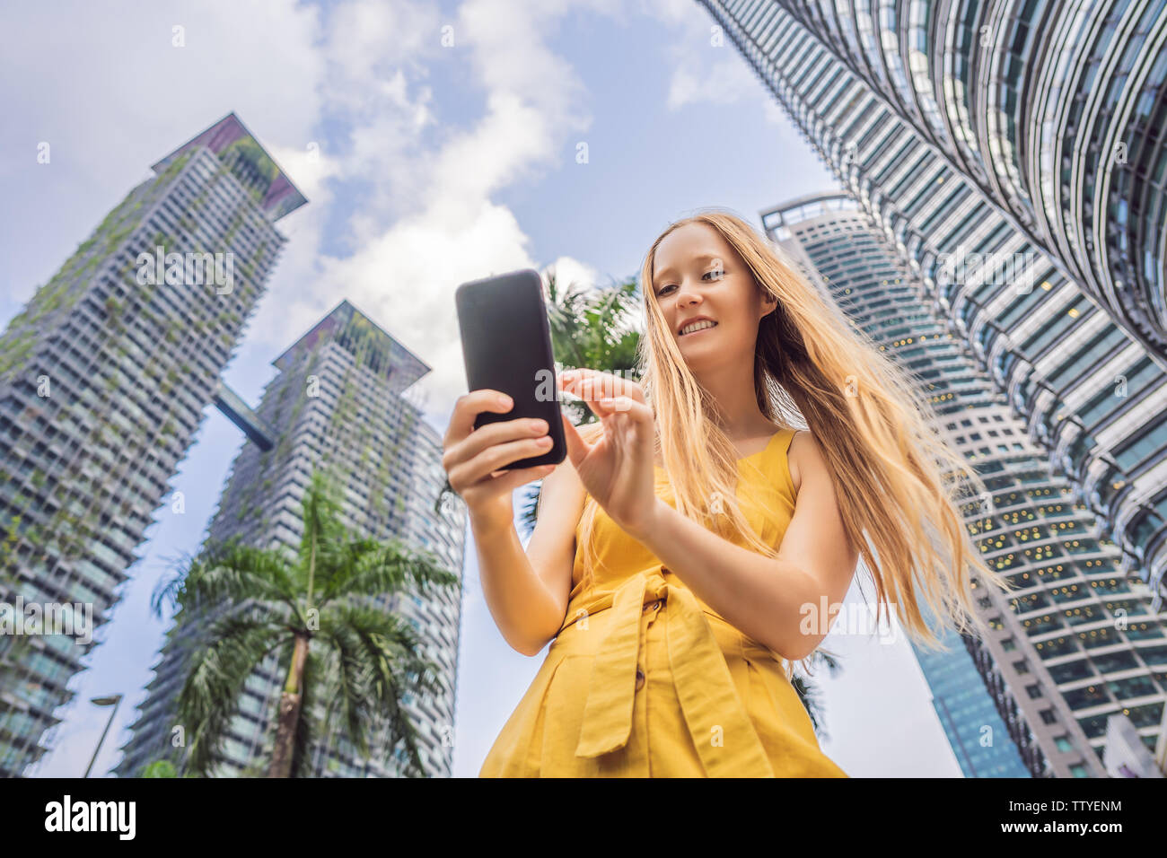 Woman Tourist using navigation app on the mobile phone. Navigation map on a smartphone in a big city Stock Photo