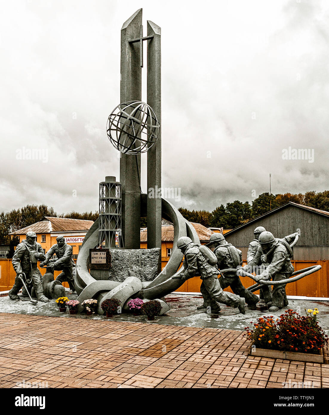 The Firemen of Chernobyl: Amonument. The nuclear accident occured during the evening of 26th April, 1986. Nothing like this had ever happened before. So what do you do? The Fire Brigade were sent in to deal with the unknown and within days they were all dead. Radiation. This eloquant and well kept monument is a tribute to their courage. 22 young lives gone. The first of many. Those in charge did not know what to do, they were scared of telling Gorbachev. He found out the next morning, with a phone call from the Swedish president, asking about a radio active cloud coming up from Ukraine - Stock Image