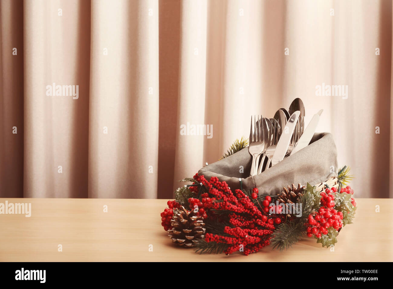 Cutlery in box on wooden table - Stock Image