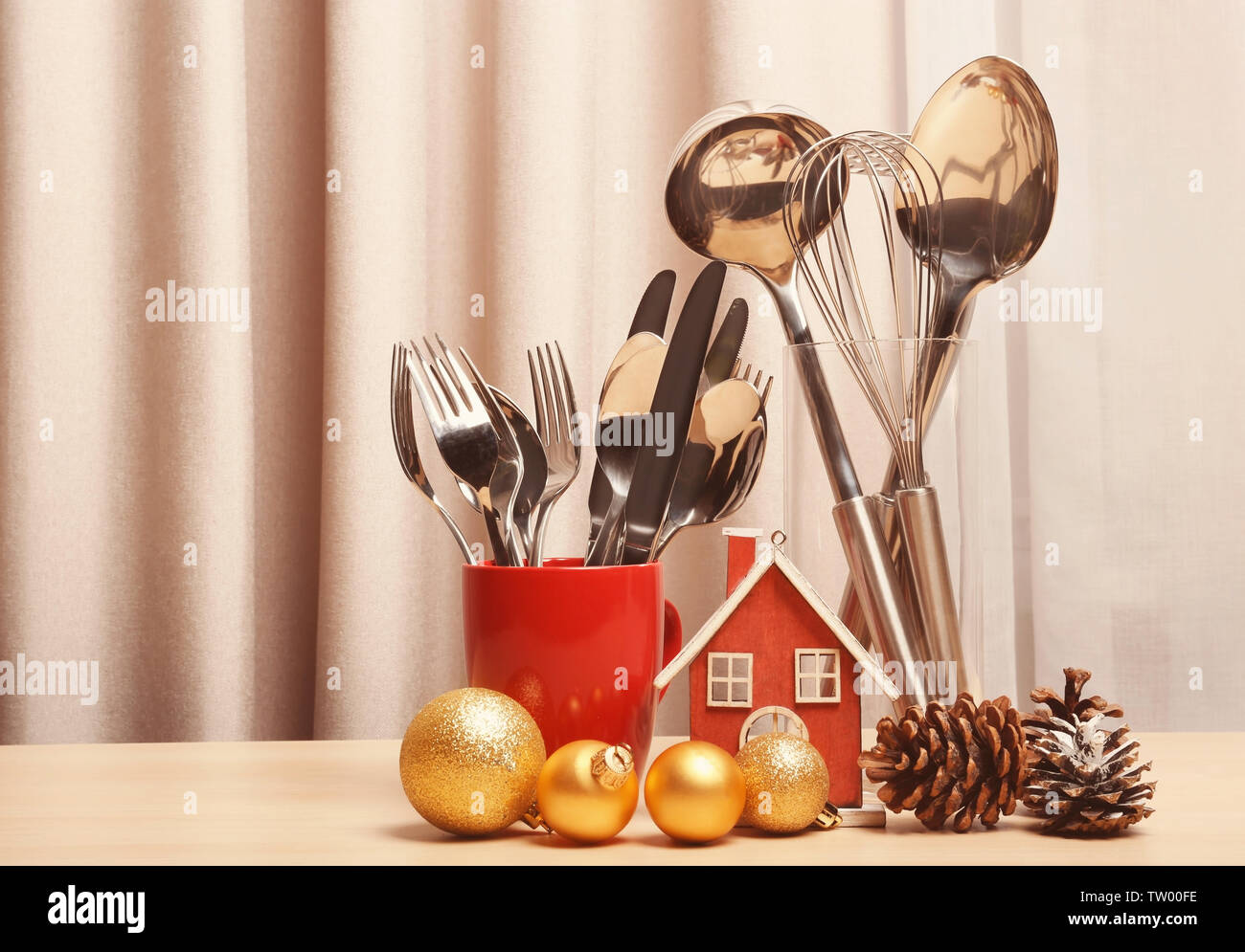 Cooking utensils and Christmas decor on table - Stock Image