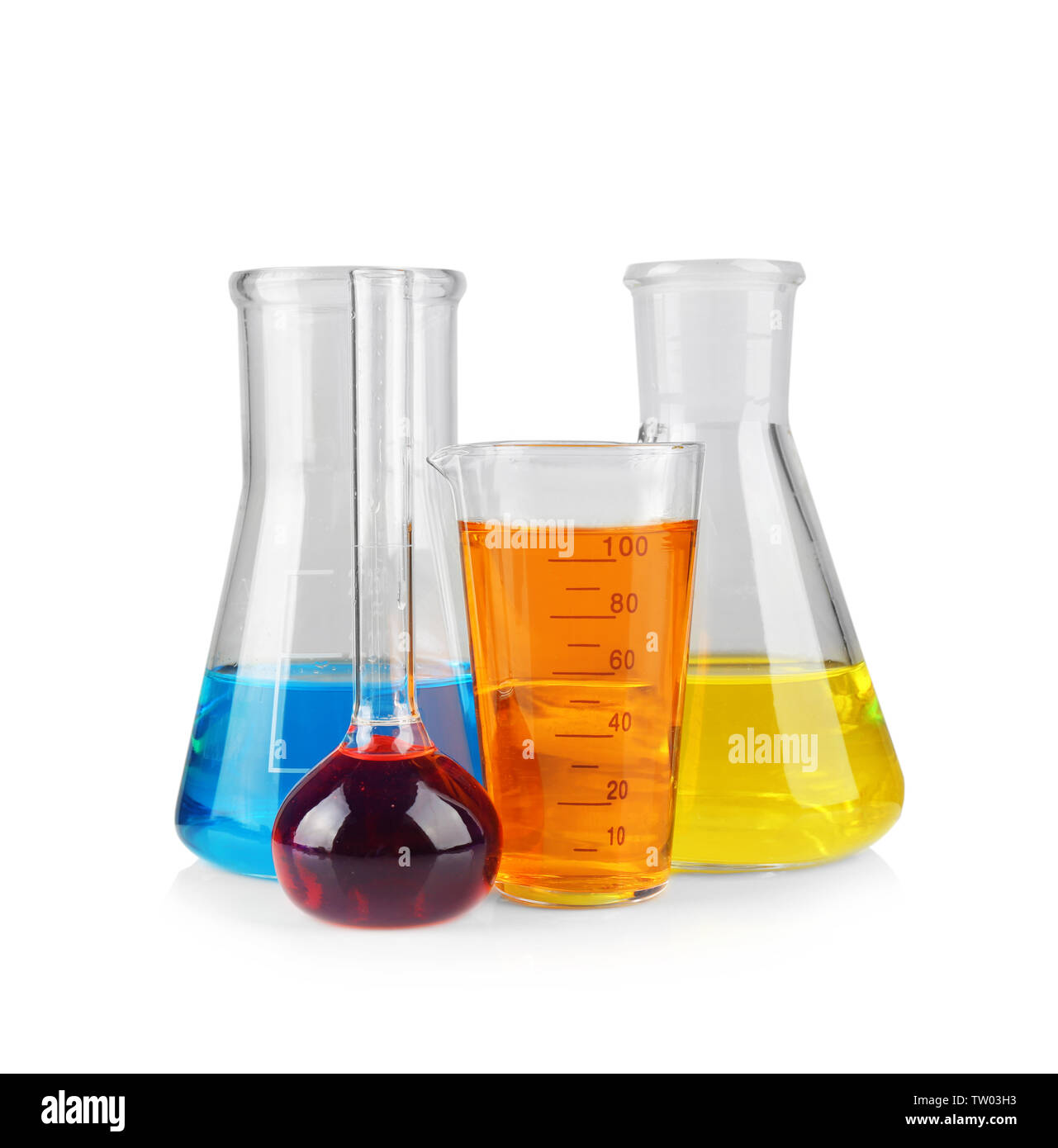 Different chemical glassware with color water on white background - Stock Image