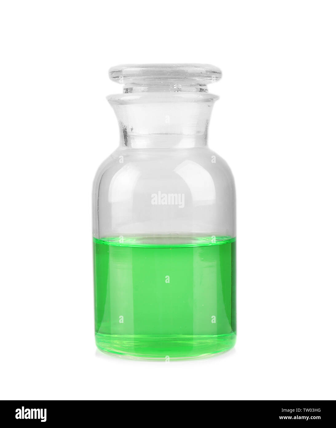 Glass bottle with color water on white background - Stock Image
