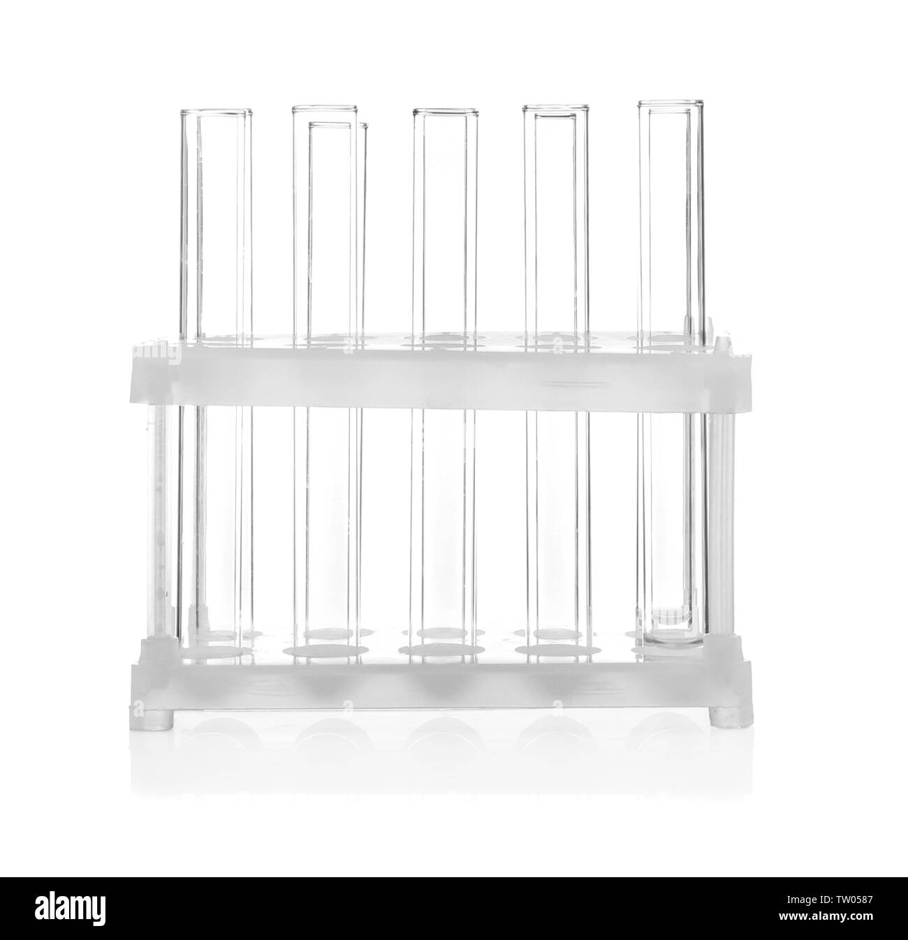 Stand with test tubes isolated on white - Stock Image