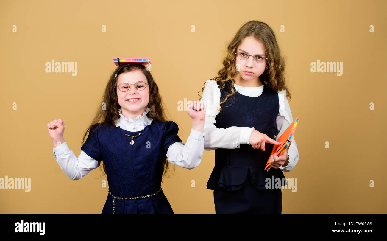 Work hard play harder. best friends since school. small girls with paper folder. hometwork together. notebook for diary notes. study lesson. knowledge and education. Back to school. - Stock Image