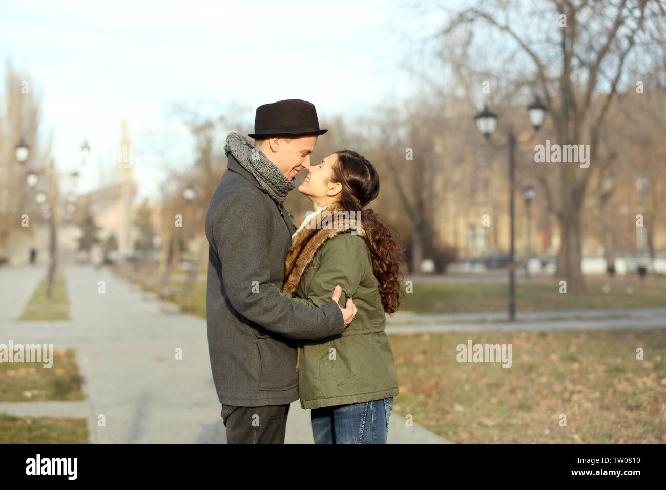 Young couple walking in park - Stock Image
