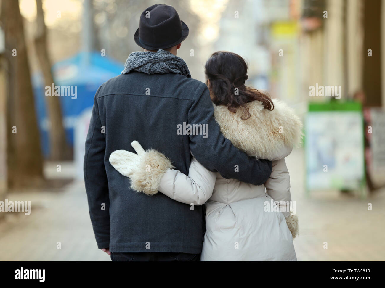 Young couple walking on the street - Stock Image