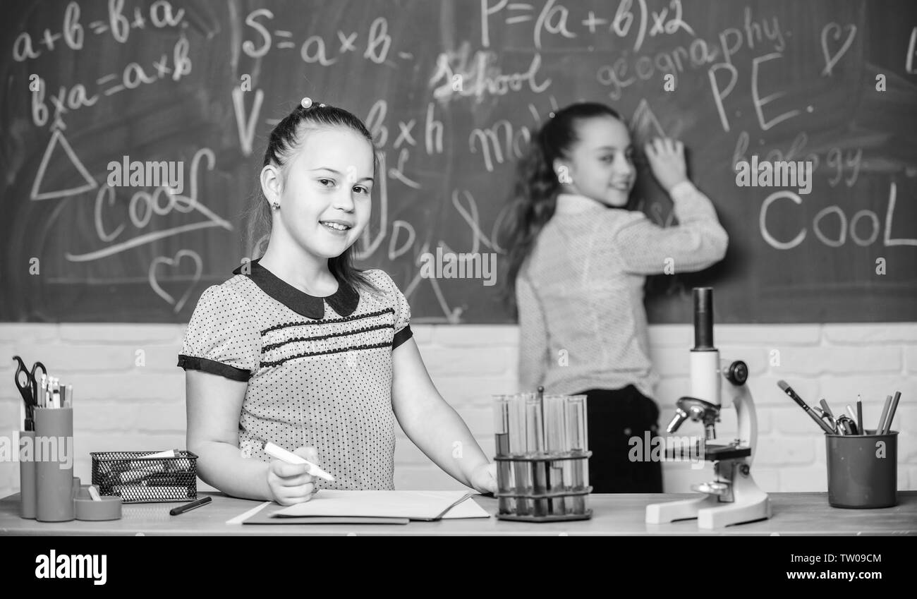 Young and confident scientist.. experiments in bilogy lab. Chemistry research. Little scientist work with microscope. Biology lesson. Back to school. Little girls in school lab. biology education. - Stock Image