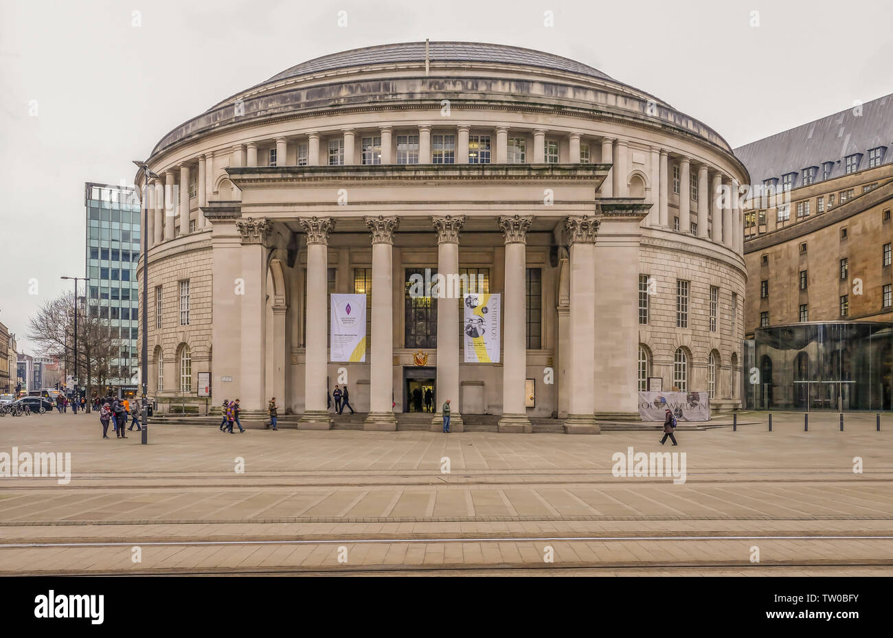 Picadilly, Manchester, UK - January 19, 2019: Central Library iconic round building with people walking around the area. - Stock Image