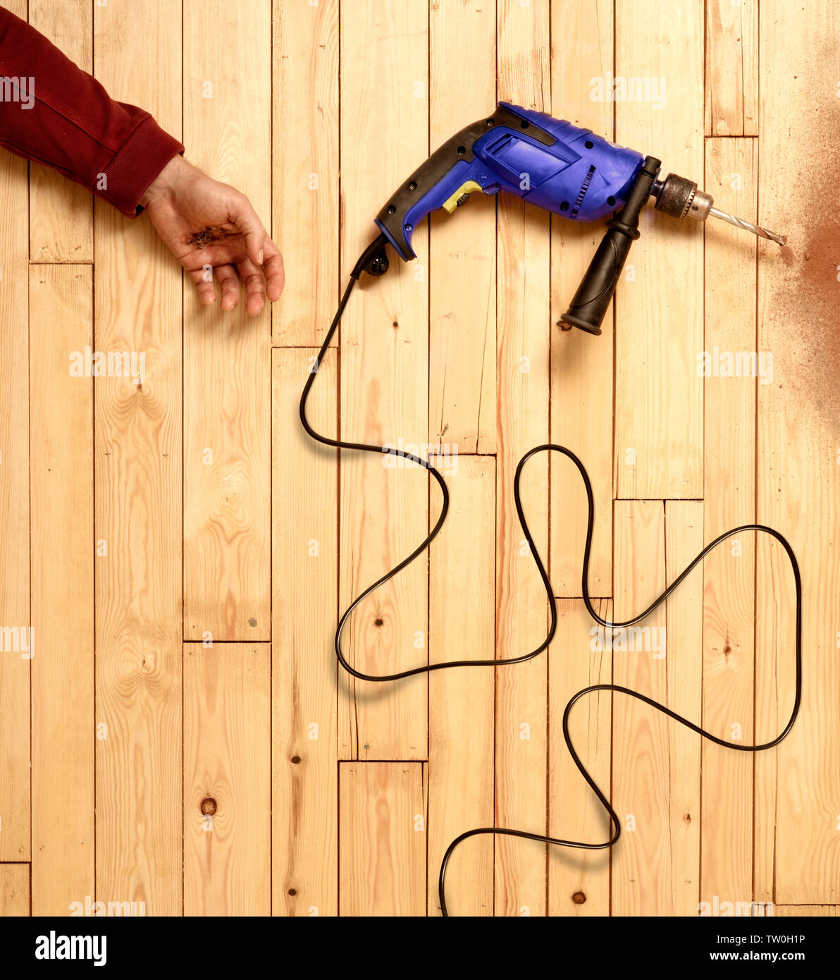 Tradesman or builder suffering an electrical accident Stock Photo