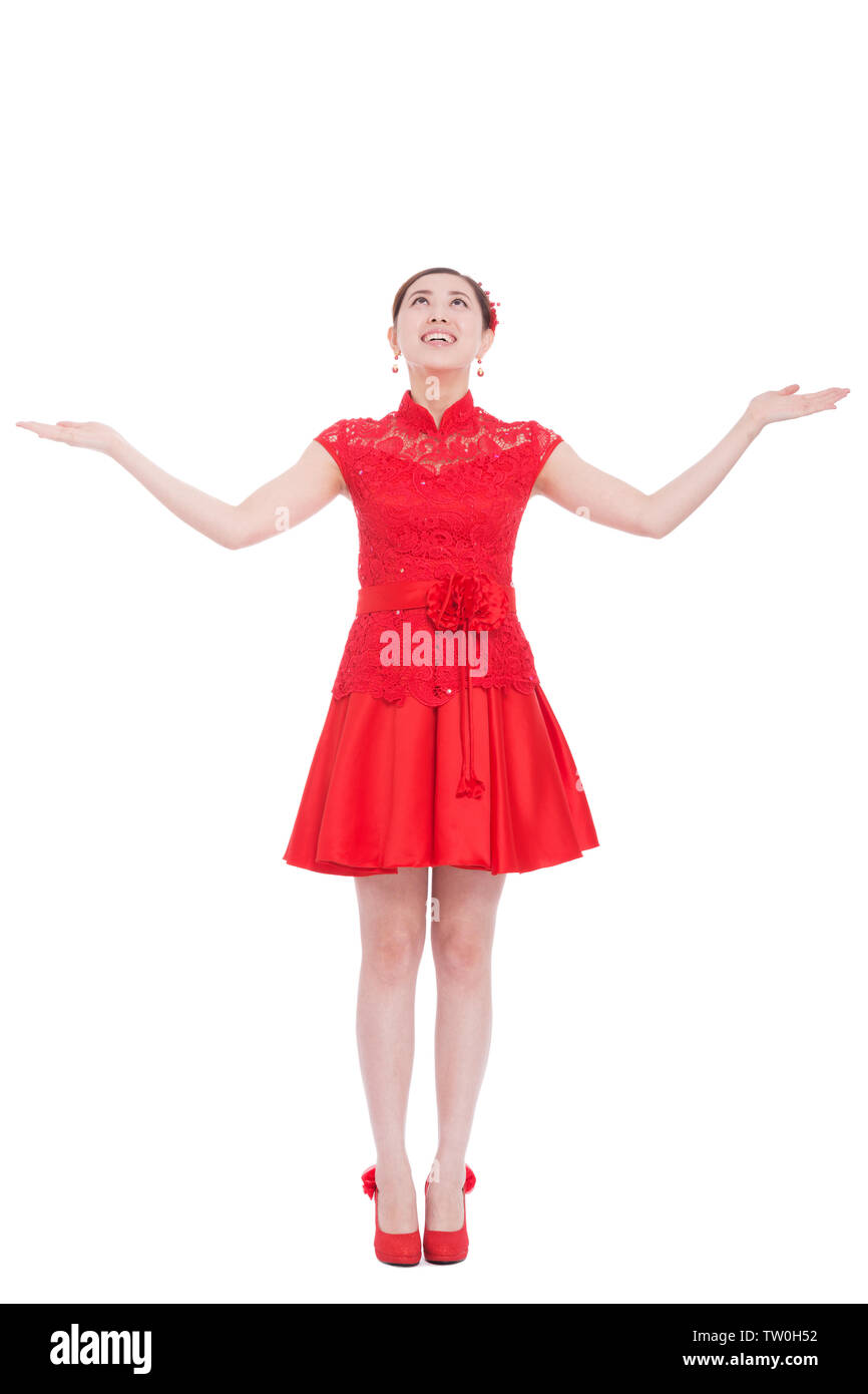 207d37036 young asian woman in red cheongsam with gesture in chinese new year - Stock  Image