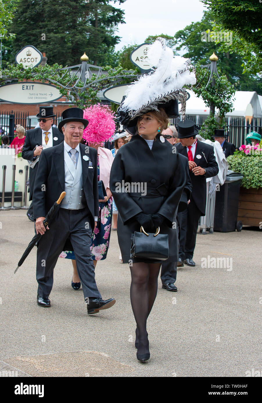 Ascot, Berkshire, UK. 18th June, 2019. A lady wears a big black and white hat on Day One of Royal Ascot, Ascot Racecourse. Credit: Maureen McLean/Alamy Live News - Stock Image