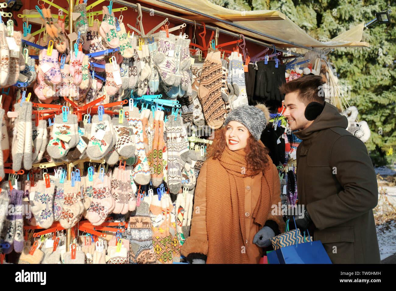 Woman and man shopping on Christmas market - Stock Image