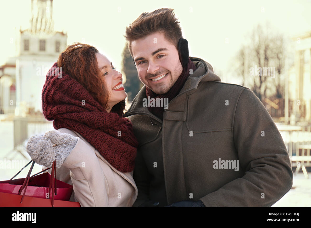 Woman and man with shopping bags on Christmas market - Stock Image