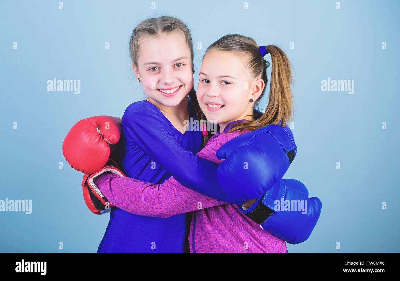 Happy children sportsman in boxing gloves. Sport success. Friendship. Fitness. energy health. workout of small girls boxer in sportswear. punching knockout. Childhood activity. I am ready to fight. - Stock Image