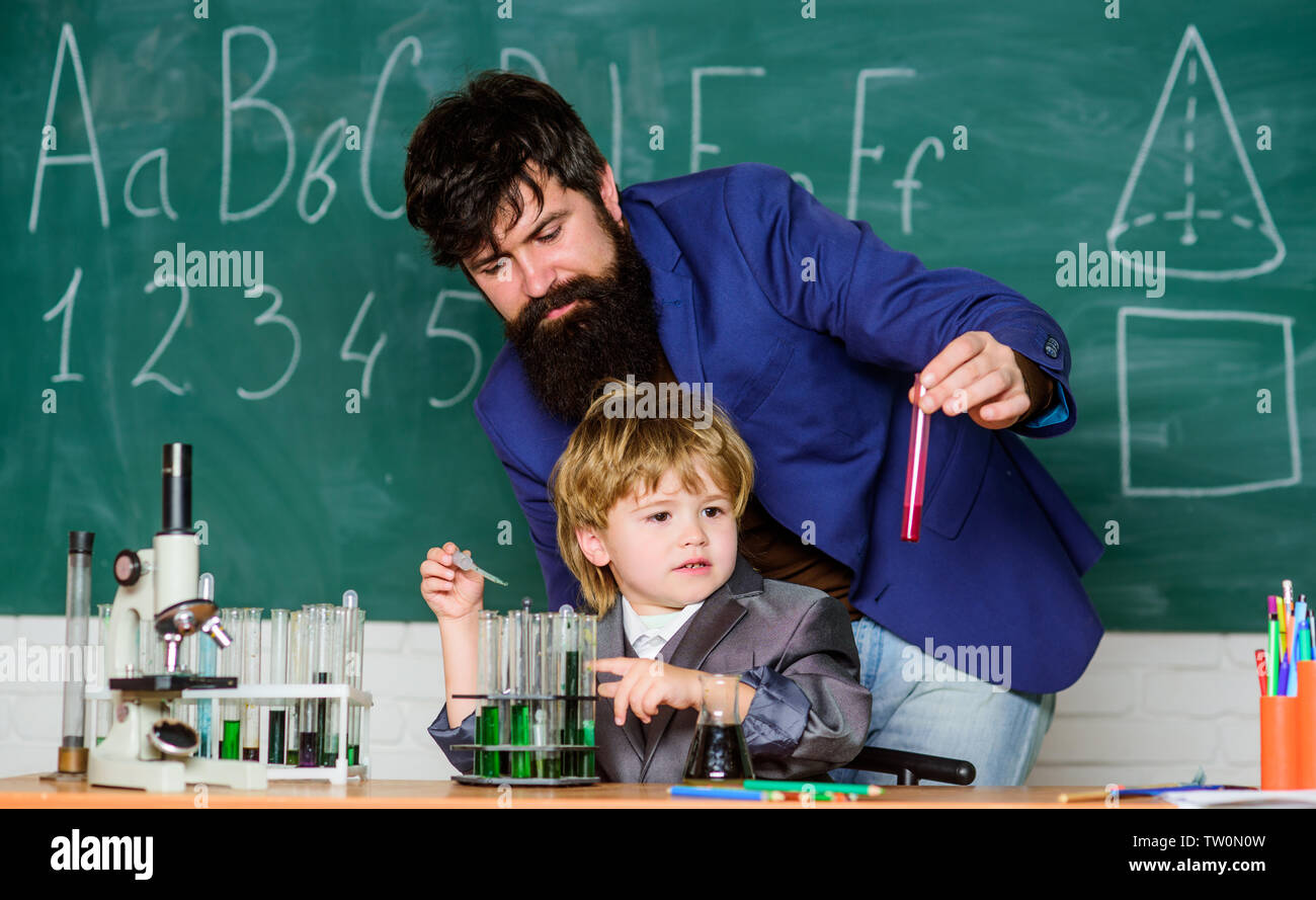 Ready to success. using microscope in lab. Back to school. father and son at school. student doing science experiments with microscope in lab. teacher man with little boy. school lab equipment. - Stock Image