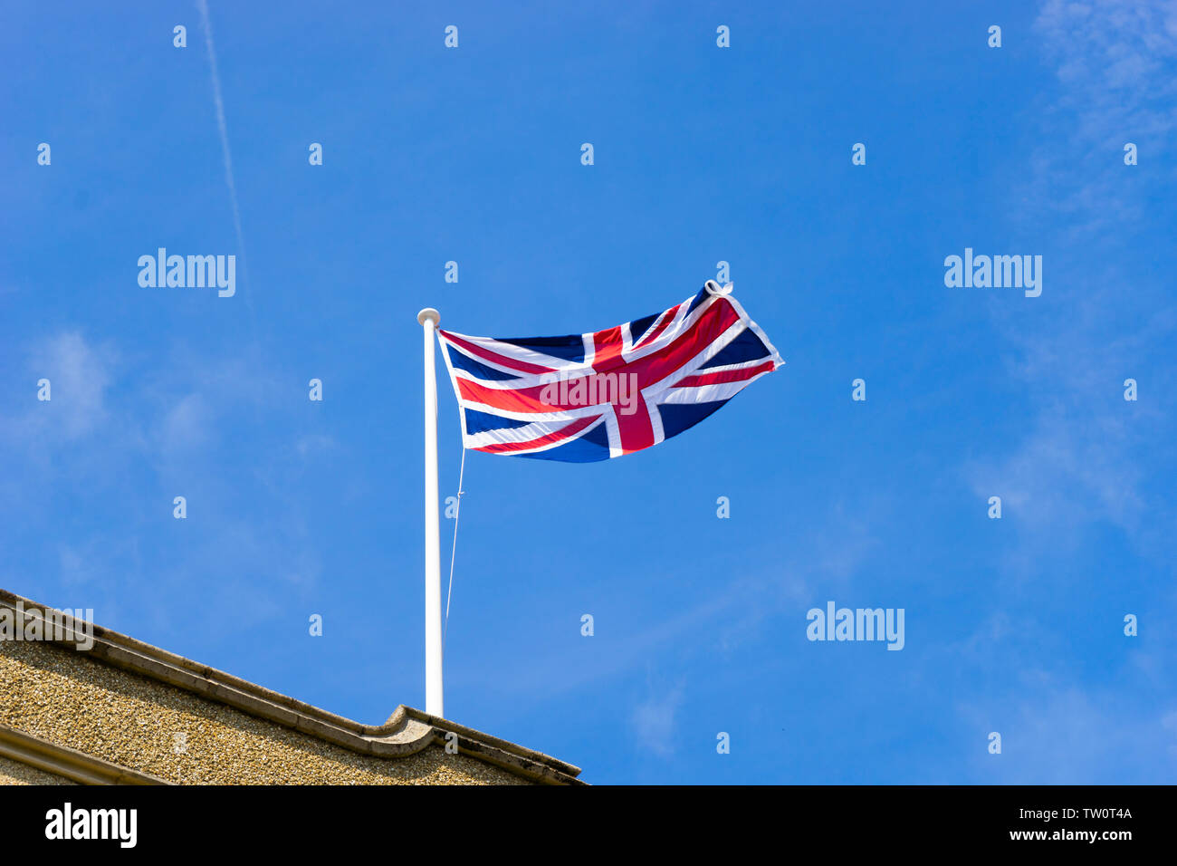 Union Jack flying in the sky on a summer afternoon - Stock Image