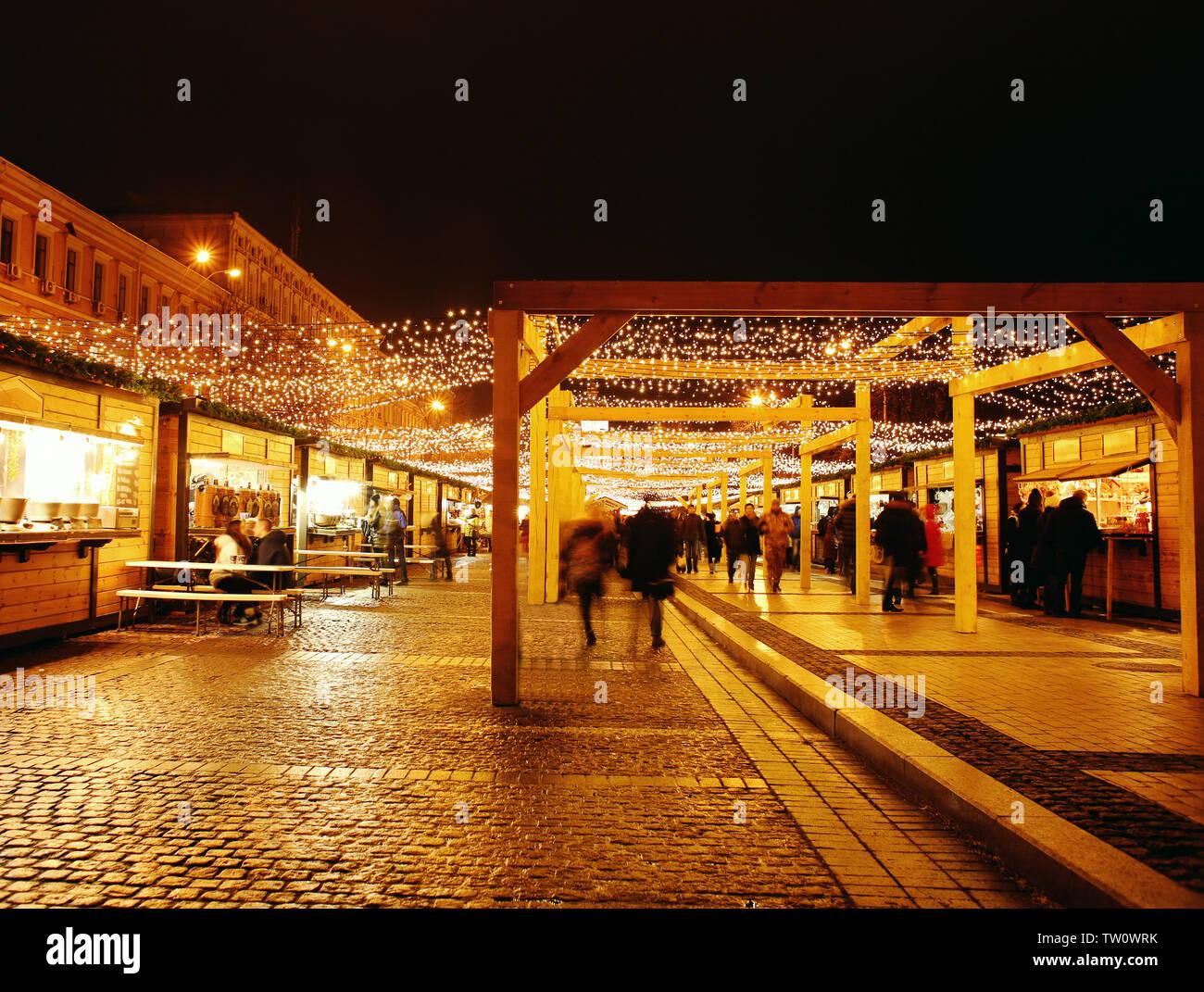 Walking people on Christmas fair - Stock Image