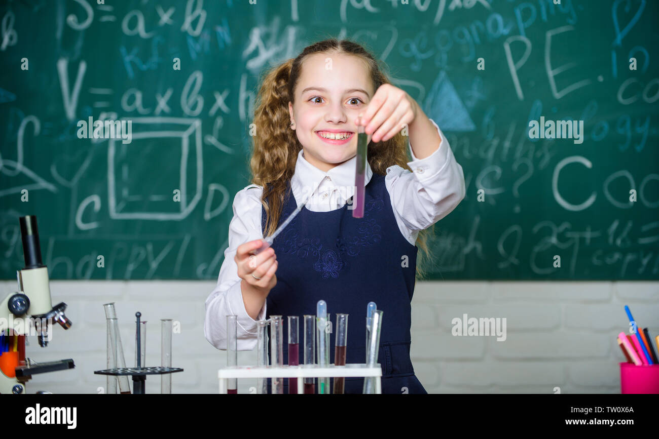 Happy child. Chemistry lesson. student doing biology experiments with microscope. Chemistry education. Chemistry equipment. Little kid learning chemistry in school lab. Concentrated on cure. - Stock Image