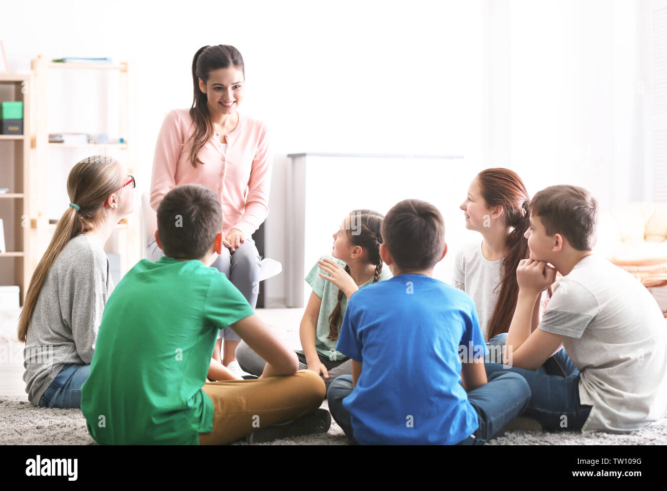 Female teacher conducting lesson at school - Stock Image