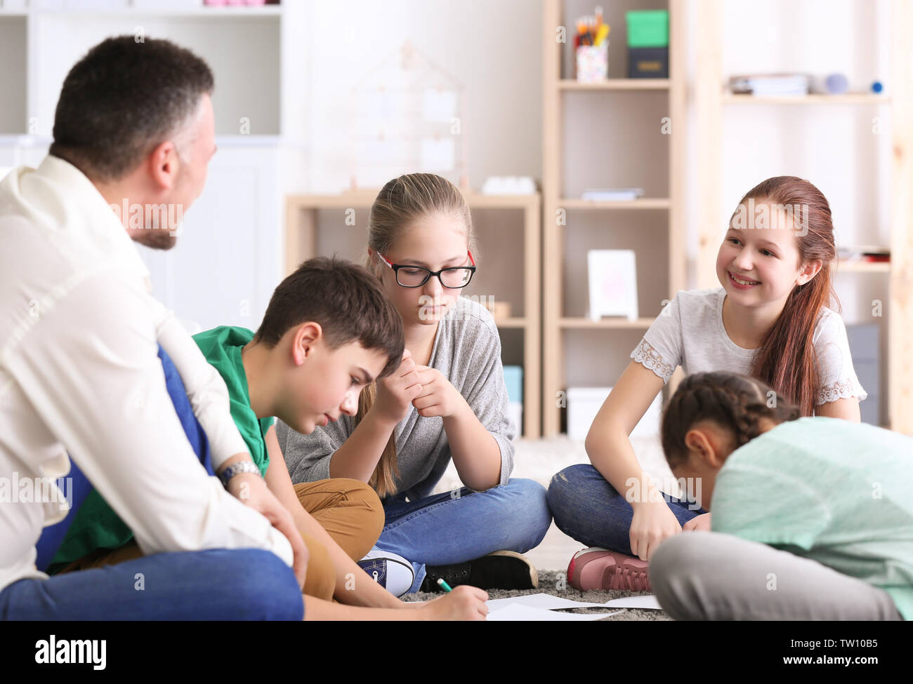 Male teacher conducting lesson at school - Stock Image