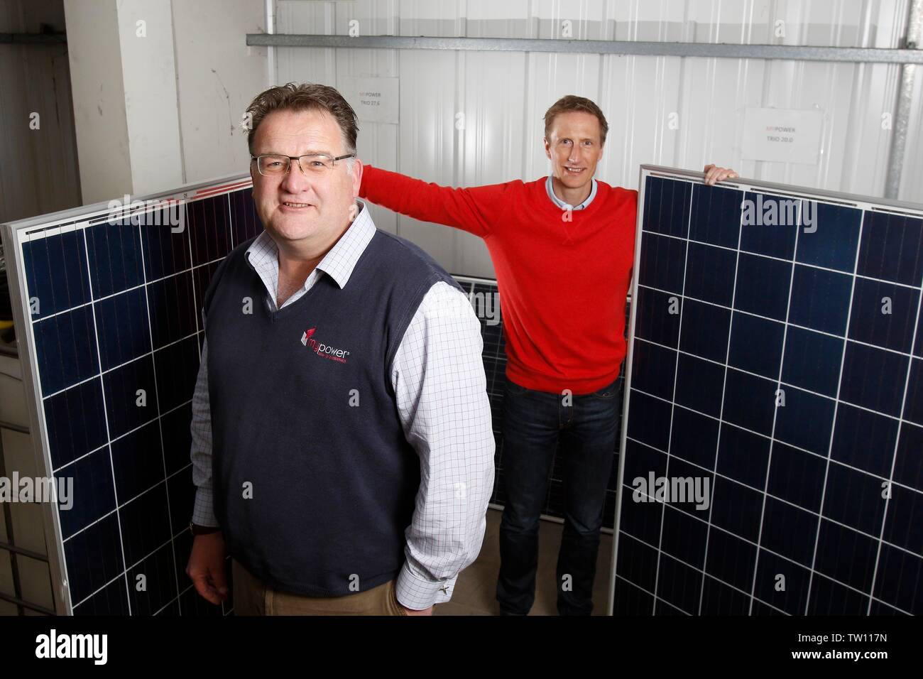 Ben Harrison, managing partner of mypower, with Neil Stott, business development manager, and two full sized solar panels, at the solar panel installa - Stock Image