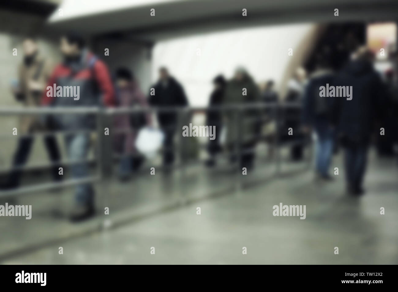 Blurred abstract background of people traffic in underground passage - Stock Image
