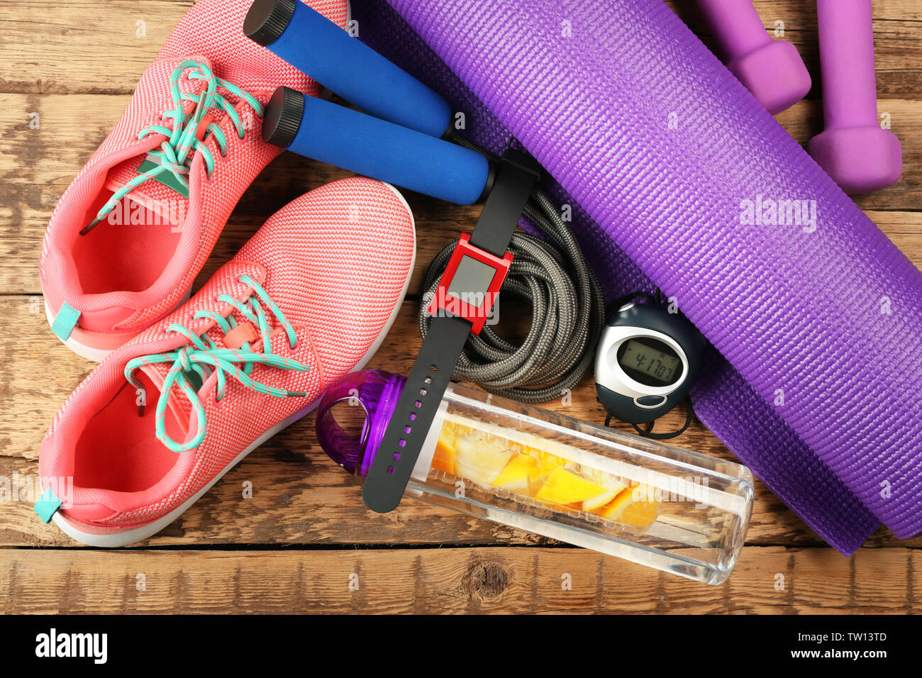 Outfit for training on wooden background - Stock Image