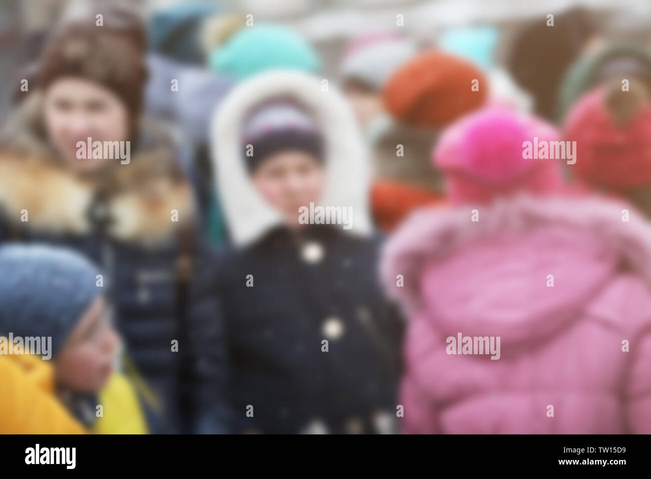 Crowd of people in warm clothes outdoors on winter day, blurred view - Stock Image