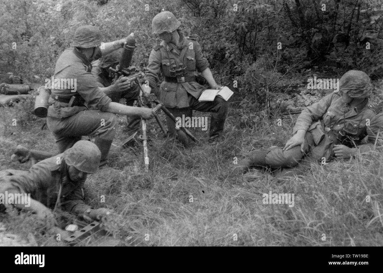 German Soldiers load a Mortar in France 1940 - Stock Image