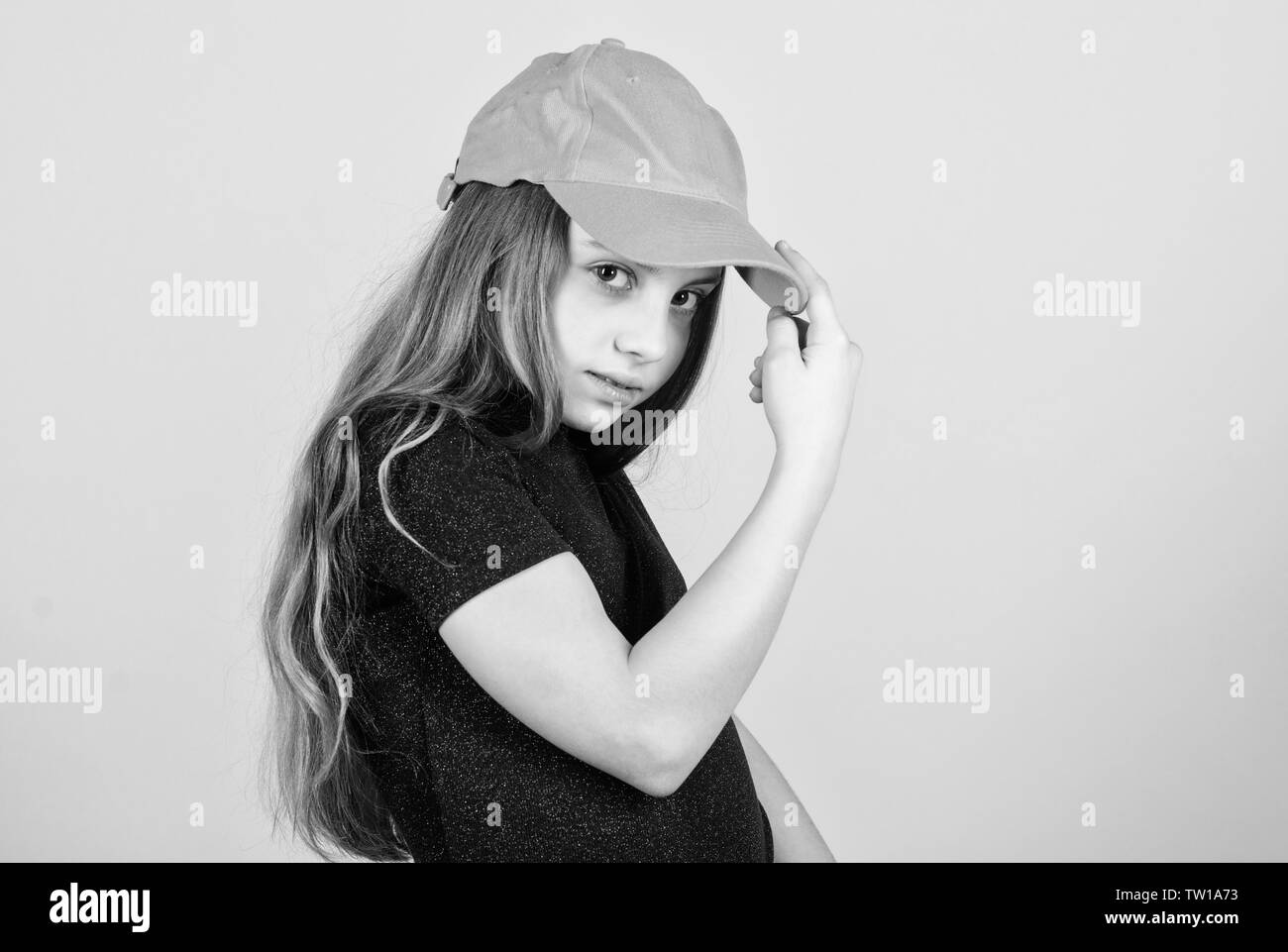 Fashion and beauty. Adorable little girl with adorable fashion look. Small cute fashion model. Fashionable child wearing fashion clothing and accessory, copy space. - Stock Image