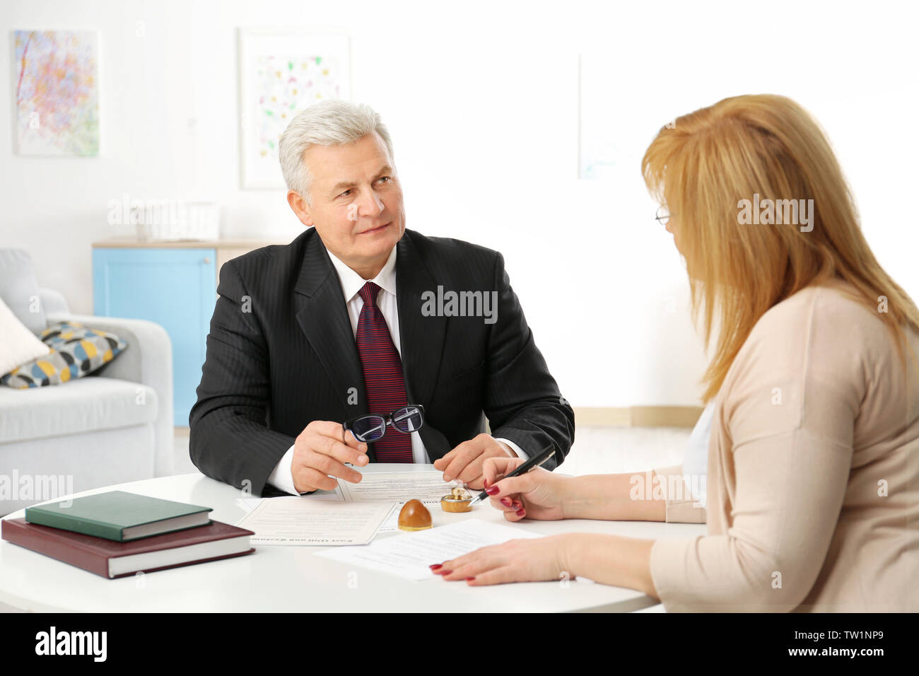 Mature woman at notary public office Stock Photo