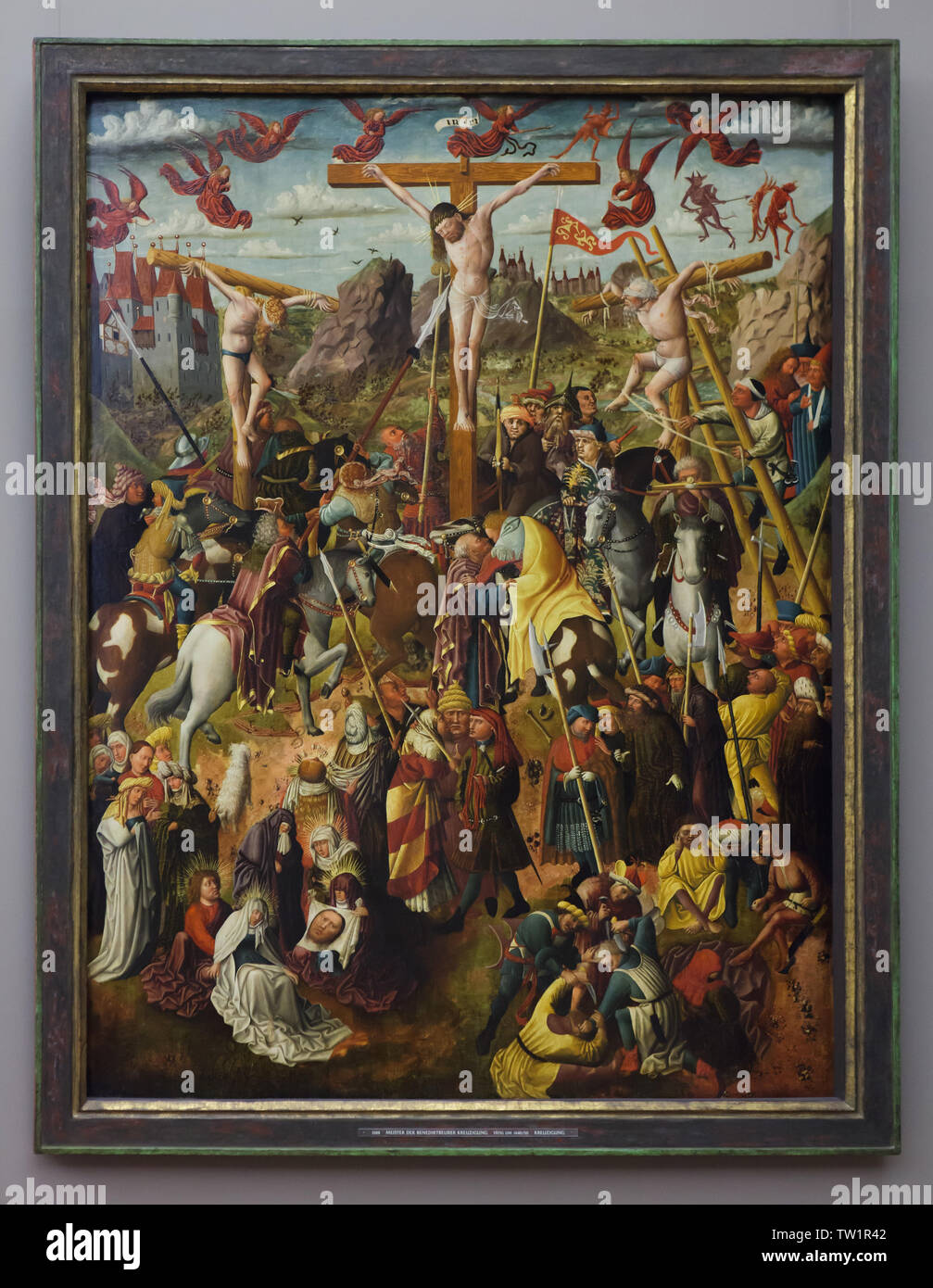 Crucifixion by Master of the Benediktbeuren Crucifixion dated from around 1455 on display in the Alte Pinakothek in Munich, Bavaria, Germany. Stock Photo