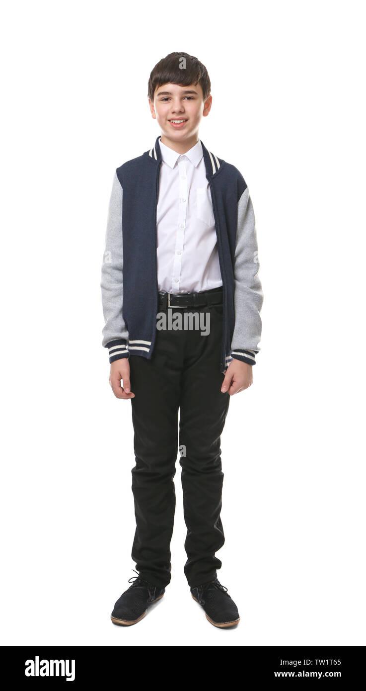 Cute boy in school uniform on white background - Stock Image
