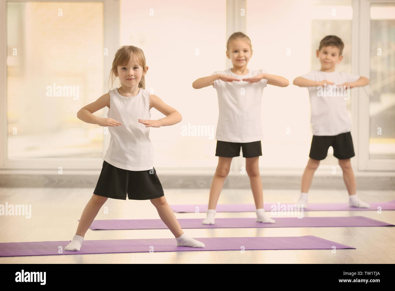 Group Happy Kids Doing Exercises High Resolution Stock Photography And Images Alamy