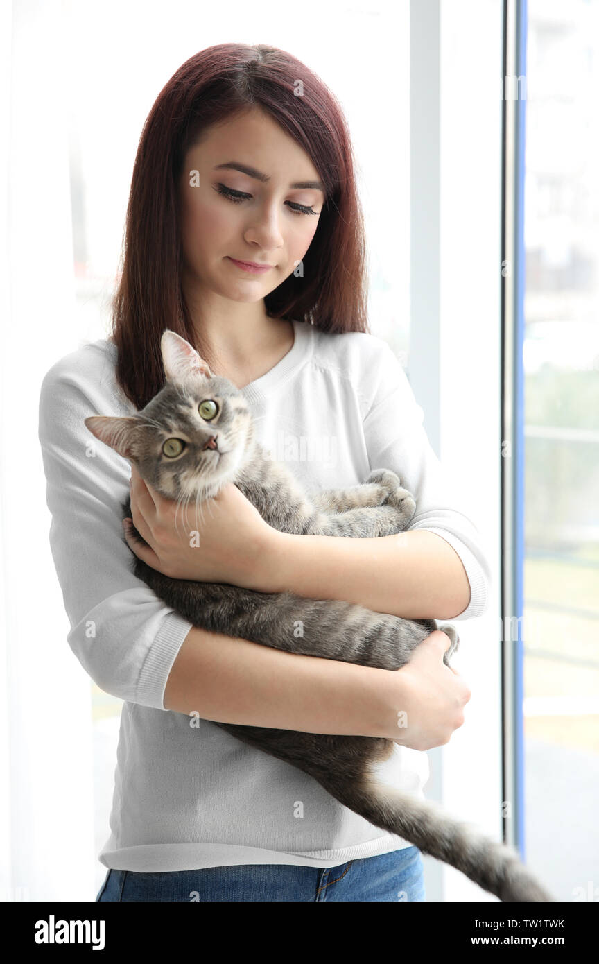 Beautiful Young Woman With Cute Cat Near Window At Home Stock Photo Alamy