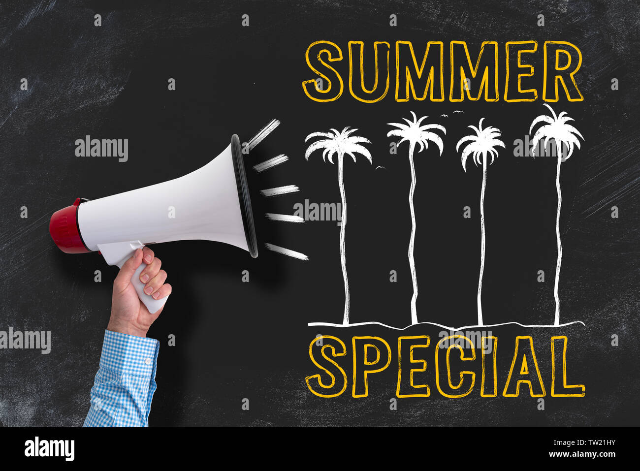 hand holding megaphone against blackboard with SUMMER SPECIAL chalk drawing - Stock Image