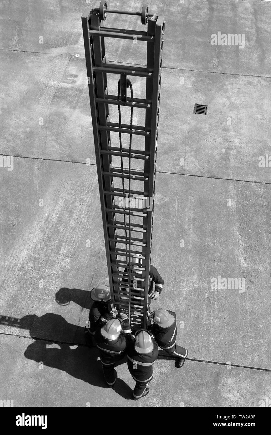 fire fighters with 13.5m ladder, working at hight - Stock Image
