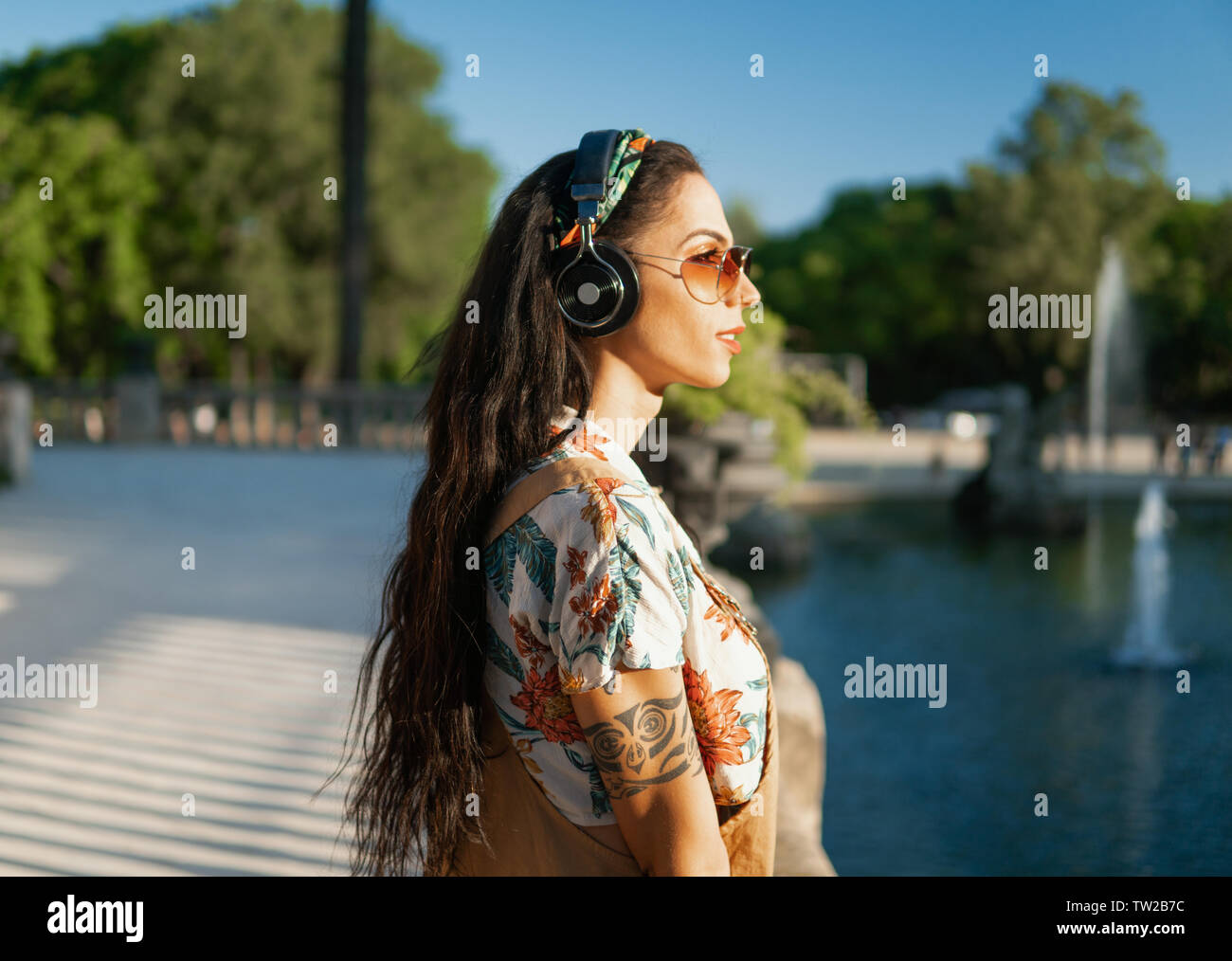 transgender model wearing sunglasses in the green park Stock Photo
