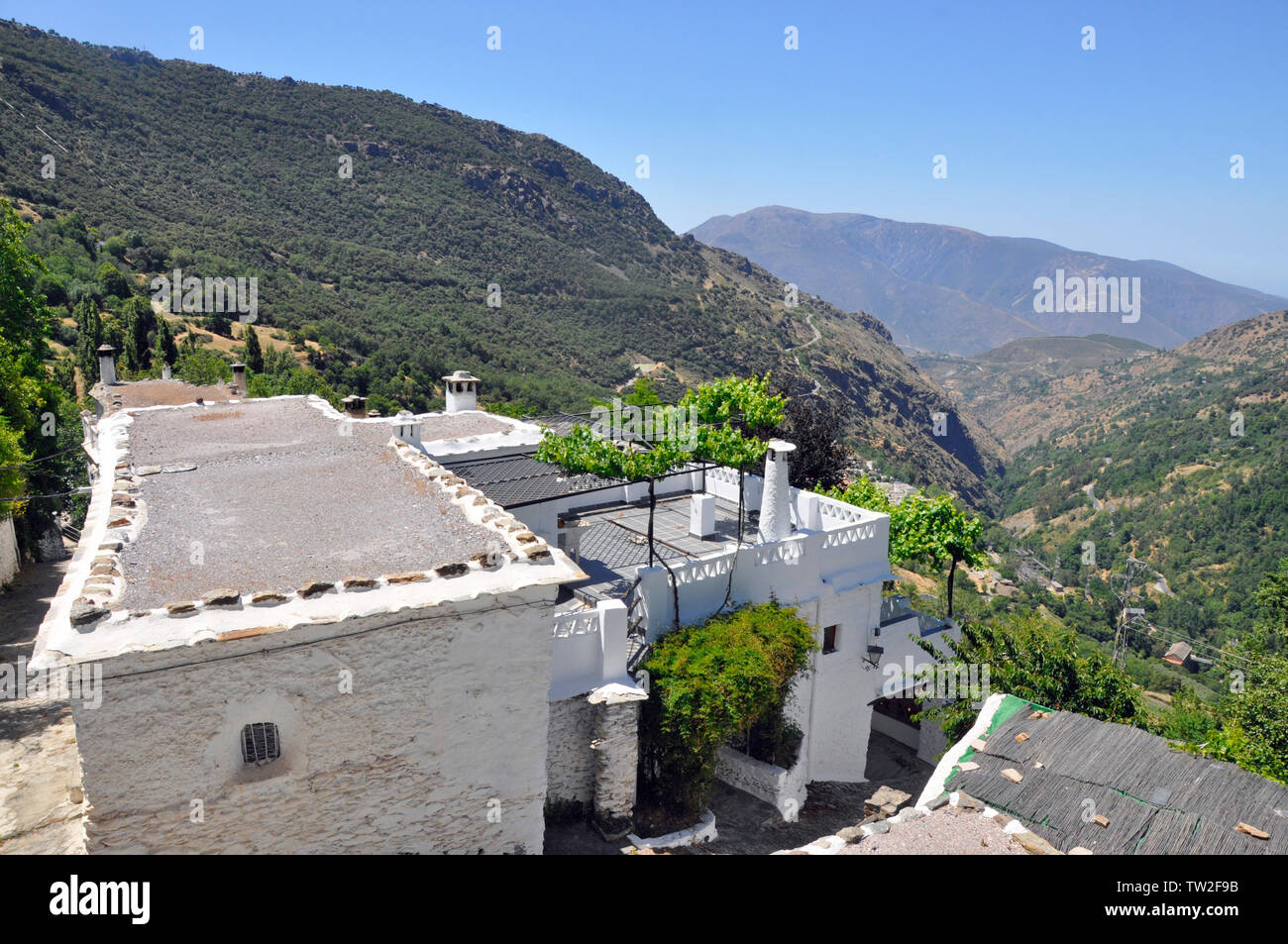 View of the Poqueira valley from the picturesque village of Bubion in Las Alpujarras, near Granada in southern Spain. Stock Photo