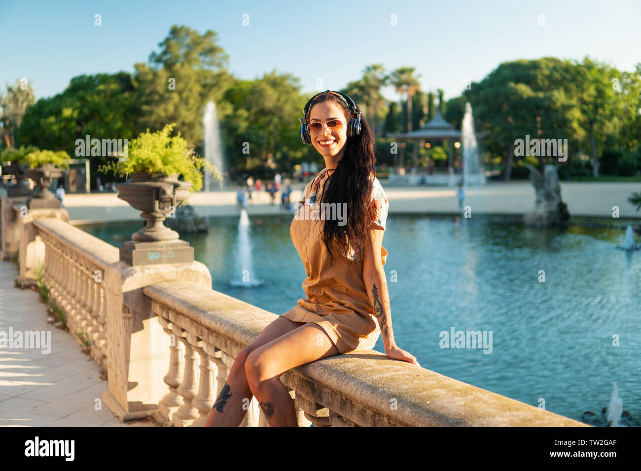 transgender model wearing sunglasses in the green park Stock Photo