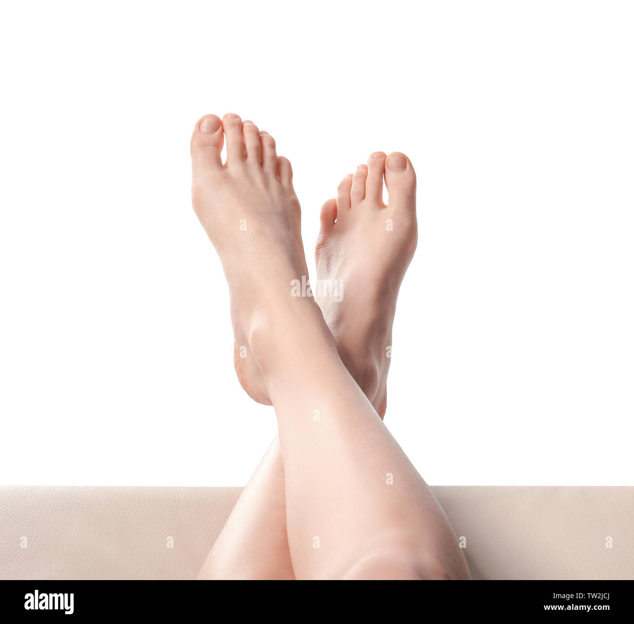 Legs of young woman taking rest, on white background Stock Photo