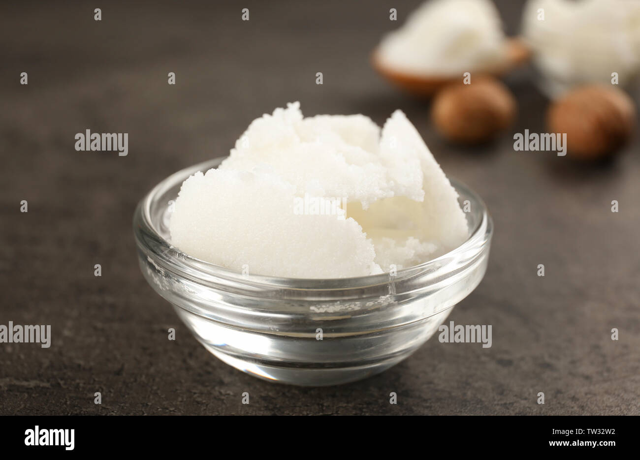 Shea butter in glass bowl on table, close up Stock Photo