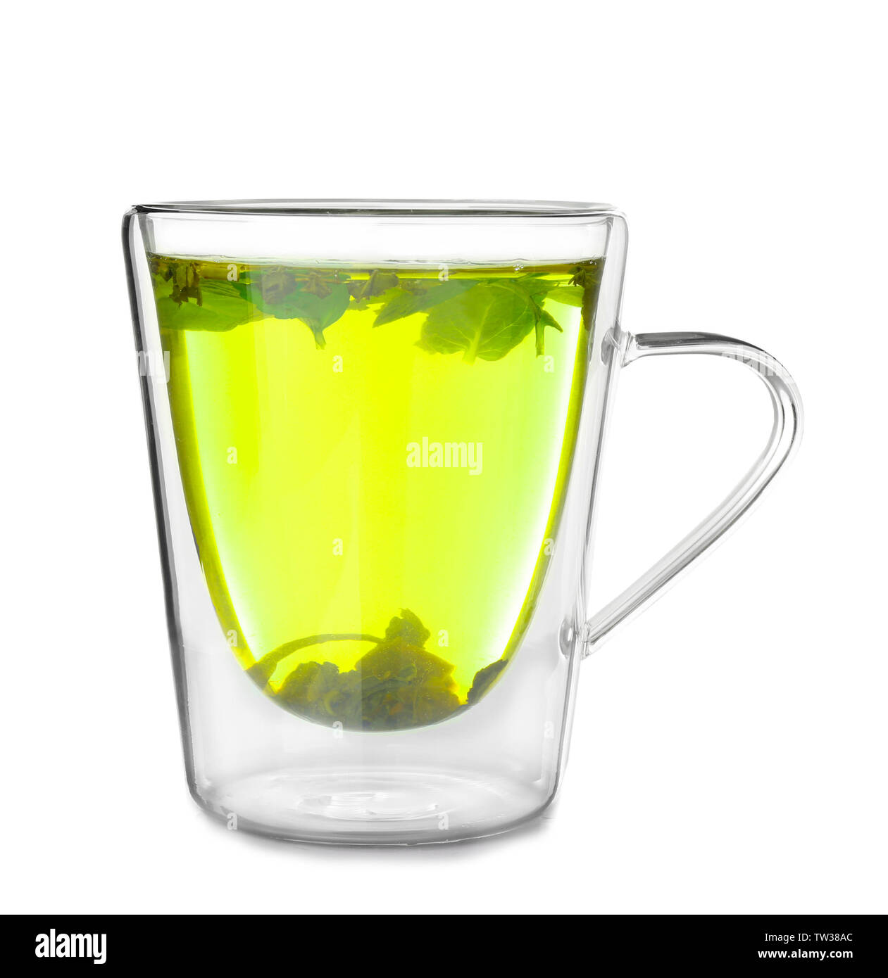 Cup of hot tasty tea with lemon balm on white background - Stock Image